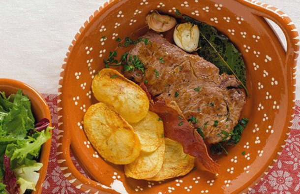 An incredibly tasty Portuguese veal steak (bife de vitela à portuguesa), served with Portuguese style chips.