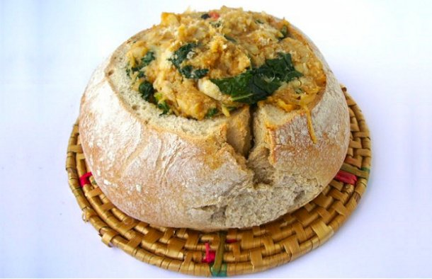 This Portuguese cod and kale stuffed bread (pão recheado com bacalhau e couve) is delicious and has great presentation.