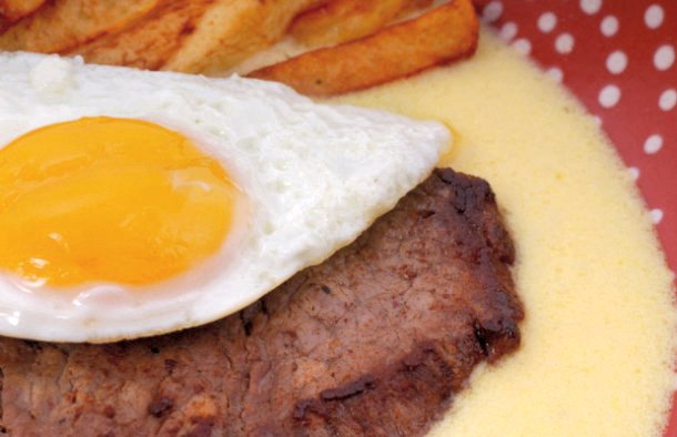 This recipe combines beer and steak into one delicious combination with a fried egg on top and French fried potatoes on the side.