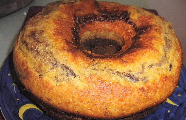 This rich and buttery Portuguese cocoa marble cake recipe (receita de  bolo mármore) contains chunks of chocolate as well.