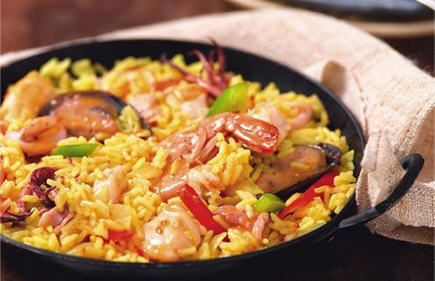 This delicious Portuguese style seafood paella recipe is very popular and the best part is you can add your favorite seafood to it.