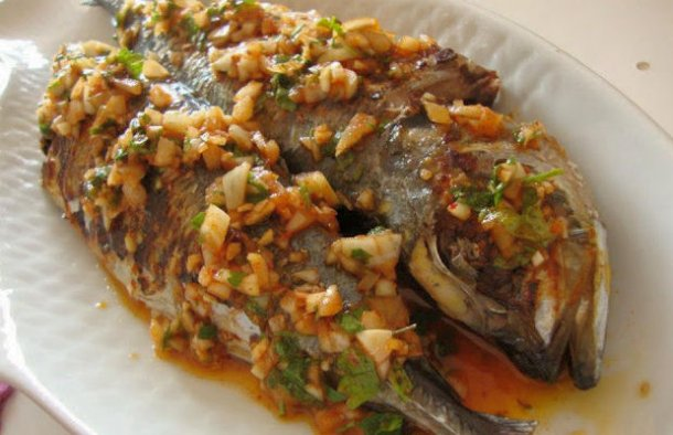 This delicious Portuguese grilled mackerel with garlic sauce recipe (cavalinhas grelhadas com molho de alho) makes a great meal for 1 person served with boiled potatoes and a salad.