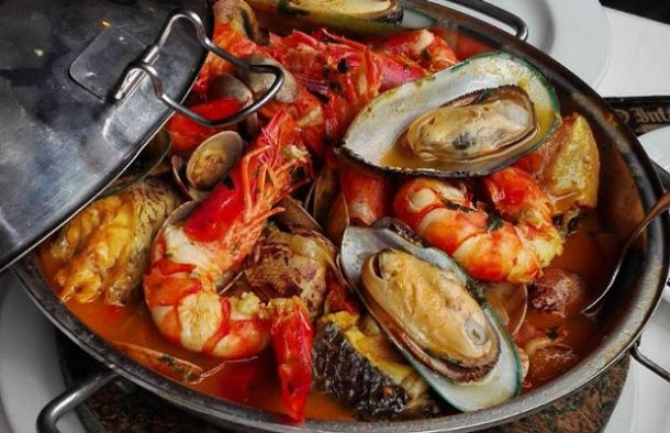 This Portuguese fish and seafood cataplana recipe (receita de cataplana de peixe e marisco) originates from the southern region of Portugal, and it's about as traditional as it gets.